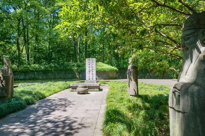 https://imgc.allpostersimages.com/img/posters/stone-statues-watching-over-an-old-tomb-in-the-gardens-of-hangzhou-zhejiang-china_u-L-PWFDNU0.jpg?p=0