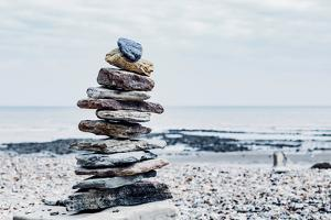 Stones Balanced on Top of One Another Suggesting Balance and Tranquility
