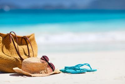 https://imgc.allpostersimages.com/img/posters/straw-hat-bag-sun-glasses-and-flip-flops-on-a-tropical-beach_u-L-Q103S070.jpg?p=0