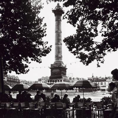 https://imgc.allpostersimages.com/img/posters/street-cafe-in-the-rain-colonne-de-juillet-c1955_u-L-F7V0CG0.jpg?p=0