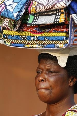 https://imgc.allpostersimages.com/img/posters/street-vendor-selling-african-cloths-lome-togo_u-L-Q1GYM3D0.jpg?artPerspective=n