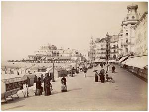 Strolling Along the Promenade at Ostende with Umbrellas - to Protect Them from the Sun