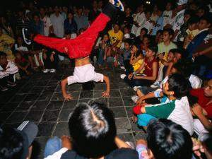 Youth Breakdancing with Crowd in Park on Dong Khoi Street, Ho Chi Minh City,  Vietnam by Stu Smucker