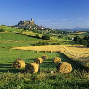 Chateau De Polignac and Hay Bales, Polignac, Haute-Loire, Auvergne, France by Stuart Black