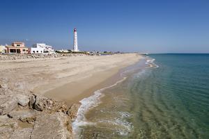 Lighthouse and beach of Ilha do Farol, Culatra barrier island, Olhao, Algarve, Portugal, Europe by Stuart Black