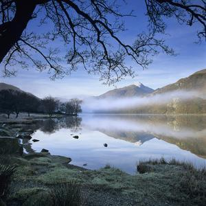 Mist over Llyn Gwynant and Snowdon, Snowdonia National Park, Conwy, Wales, United Kingdom, Europe by Stuart Black