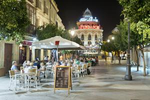 Night view of cafes along Calle Lanceria and El Gallo Azul rotunda building, Jerez de la Frontera,  by Stuart Black