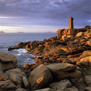 Ploumanach Lighthouse on the Cote De Granit Rose (Pink Granite Coast) by Stuart Black