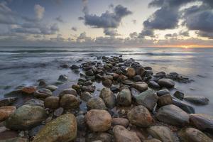 Rock breakwater in sea at sunrise, Munkerup, Kattegat Coast, Zealand, Denmark, Scandinavia, Europe by Stuart Black