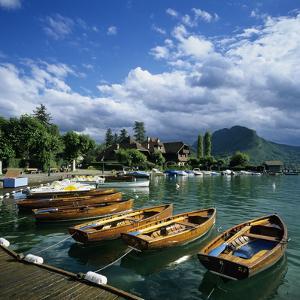 Rowing Boats Along Lake Shore, Talloires, Lake Annecy, Rhone Alpes, France, Europe by Stuart Black
