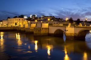 Seven arched Roman bridge and town on the Rio Gilao river at night, Tavira, Algarve, Portugal, Euro by Stuart Black