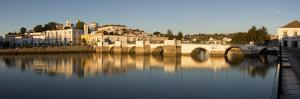 Seven arched Roman bridge and town on the Rio Gilao river, Tavira, Algarve, Portugal, Europe by Stuart Black