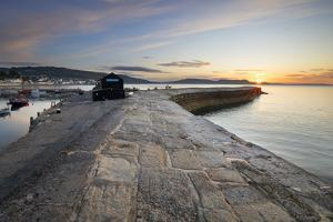 The Cobb with the cliffs of Jurassic Coast at sunrise, Lyme Regis, Dorset, England, United Kingdom, by Stuart Black