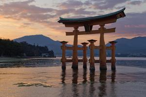 The Floating Miyajima Torii Gate of Itsukushima Shrine at Sunset by Stuart Black
