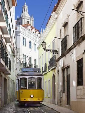 Tram (Electricos) Along Rua Das Escolas Gerais with Tower of Sao Vicente de Fora, Lisbon, Portugal by Stuart Black
