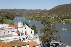 View over whitewashed village of Alcoutim on Rio Guadiana river, Alcoutim, Algarve, Portugal, Europ by Stuart Black