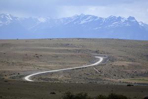 Winding desert road and Andes mountains, El Calafate, Parque Nacional Los Glaciares, UNESCO World H by Stuart Black