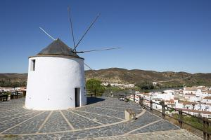 Windmill above village and Rio Guadiana river with view to Portugal, Sanlucar de Guadiana, Huelva P by Stuart Black