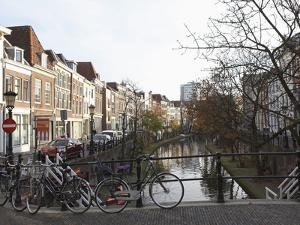 Looking Along the Catharijnsingel, Bicycles Stand on a Bridge over a Canal in Utrecht, Utrecht Prov by Stuart Forster