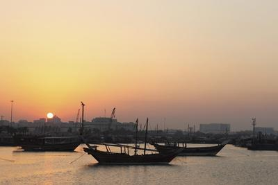Traditional Wooden Dhow Boats in the Corniche Marina, at Sunset in Doha, Qatar, Middle East