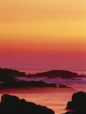 Offshore Rocks at Sunset, Pacific Grove, Monterey Peninsula, California, USA by Stuart Westmoreland