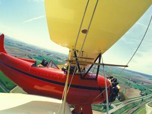 Passenger and Pilot in Biplane over Tulip Fields, Skagit Valley, Washington, USA by Stuart Westmoreland