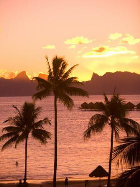 Sunset over Moorea, near Papeete, Tahiti Nui, Society Islands, French Polynesia, South Pacific by Stuart Westmoreland