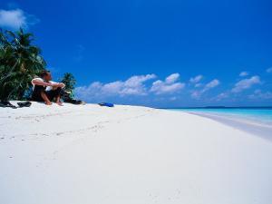 Businessman on Beach, Maldives by Stuart Westmorland