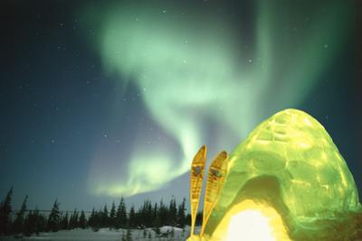 Igloo Light, Aurora borealis, Canadian Arctic by Stuart Westmorland