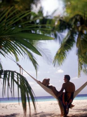 Silhouetted Couple, Felidu Atoll, Maldives by Stuart Westmorland