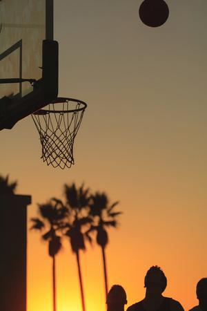 Sunset scenes, Venice Beach, Southern California, USA. Outdoor basketball court