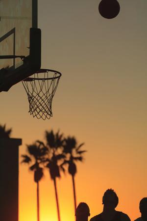 Sunset scenes, Venice Beach, Southern California, USA. Outdoor basketball court by Stuart Westmorland