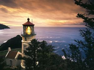 View of Heceta Head Lighthouse at Sunset, Oregon, USA by Stuart Westmorland