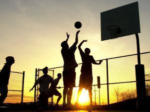 Students Play a Basketball Game as the Sun Sets at Bucks County Community College