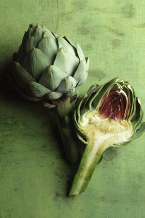 A Whole and a Half Artichoke on Green Background by Studio DHS