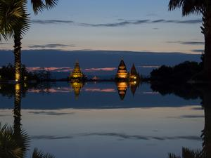 Stupas illuminated at night near infinity pool of Aureum Palace Hotel, Bagan, Mandalay Region, M...