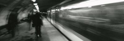 https://imgc.allpostersimages.com/img/posters/subway-train-passing-through-a-subway-station-london-england_u-L-P18JX10.jpg?p=0