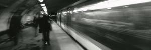 Subway Train Passing through a Subway Station, London, England