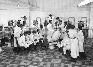 A Boy's Class in Barbering in Paris, 1936 by Süddeutsche Zeitung Photo