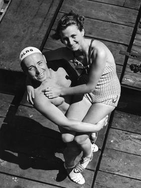 A Lifeguard Posing with a Female Swimmer, 1939 by Süddeutsche Zeitung Photo