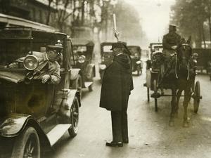 Traffic Policeman in Paris, 1930's by Süddeutsche Zeitung Photo