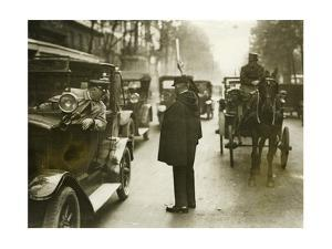 Traffic Policeman in Paris, 1930's by Süddeutsche Zeitung Photo