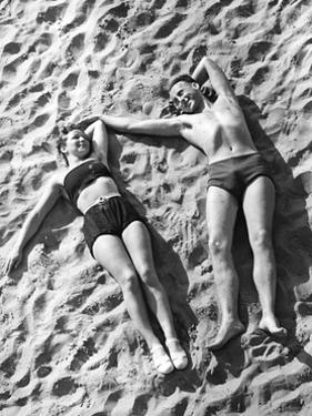 Young Couple Sunbathing, 1939 by Süddeutsche Zeitung Photo