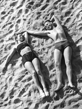 Young Couple Sunbathing, 1939 by Süddeutsche Zeitung Photo