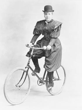 Suffragette Dressed in Man's Hat on Bicycle