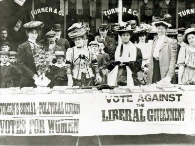 https://imgc.allpostersimages.com/img/posters/suffragettes-at-a-campaign-stand-c-1910_u-L-P56UPJ0.jpg?p=0