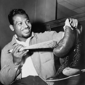 Sugar Ray Robinson Dusting Off His Boxing Gloves for His 1954 Comeback Fight