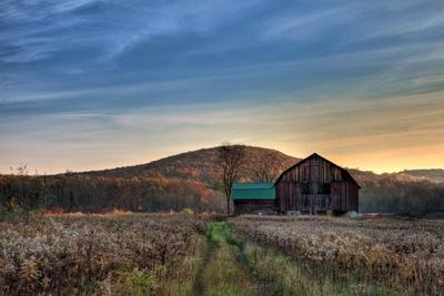 https://imgc.allpostersimages.com/img/posters/sun-begins-to-rise-over-a-rustic-old-barn_u-L-Q1DD77D0.jpg?p=0