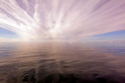https://imgc.allpostersimages.com/img/posters/sun-rays-through-clouds-above-the-ocean-greenland_u-L-Q10VHGL0.jpg?p=0