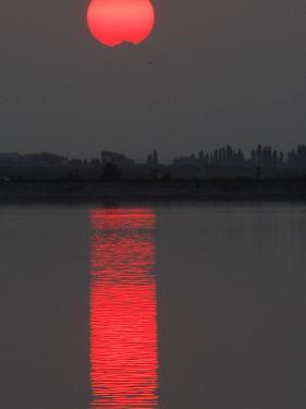 Sun Sets over a Lake on the Outskirts of Bucharest, Romania